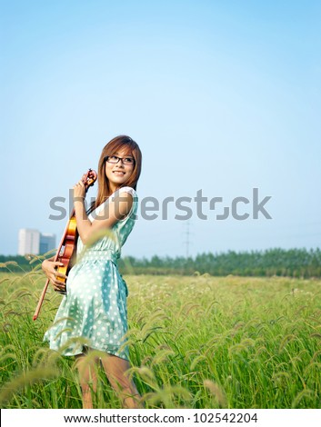 Young girl holding her violin