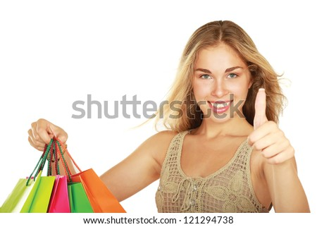 Young girl holding shopping bag and showing ok, isolated on white background