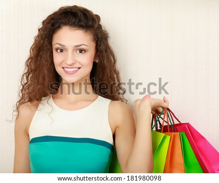 Young girl holding shopping bag, isolated on white background - stock photo