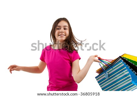 Young girl holding shopping bags isolated on white background