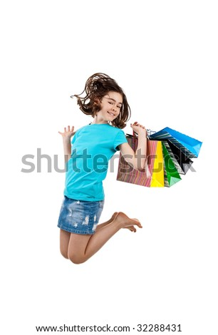Young girl holding shopping bags jumping isolated on white background