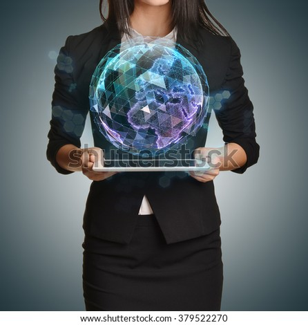 Young girl holding tablet in the hands of virtual digital globe