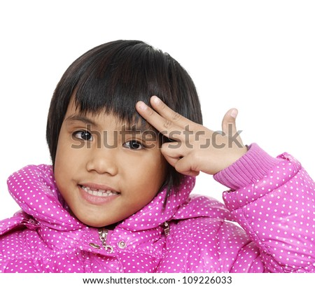 Young girl holds hands at a head