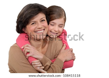 Young girl hugging her grandmother - stock photo