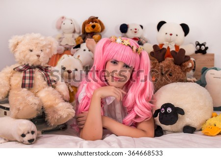 young girl in a bedroom in a pink cute dress