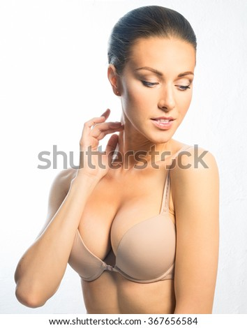 Young girl in a beige bra - stock photo