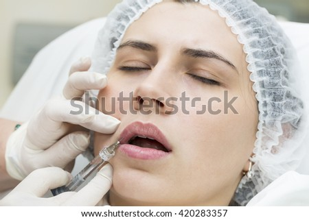 young girl in a clinic contour lips procedure