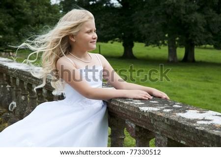 young girl in a garden - stock photo
