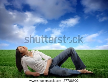 young girl in a grass field - stock photo