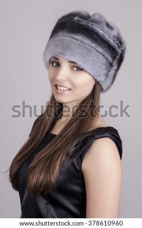 Young girl in a hat. Natural fur Mink.