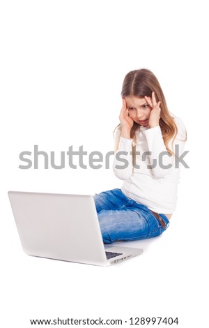 young girl in a horror crying in front of the monitor laptop - stock photo