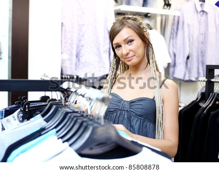 Young girl in a shop buying clothes