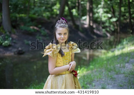 Young girl in a vintage dress in the forest