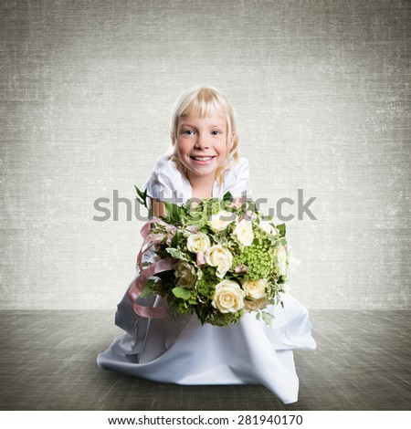young girl in a white dress with a bouquet of flowers - stock photo
