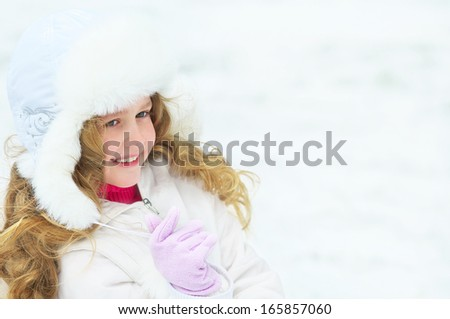 Young girl in a winter scene - stock photo