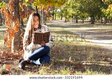 young girl in autumn outdoors