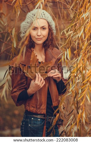 young girl in autumn park - stock photo