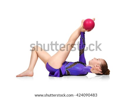 young girl in blue clothes doing gymnastics with red ball