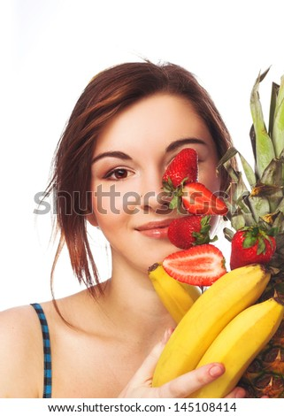 Young girl in blue dress with fruits in her hands - stock photo