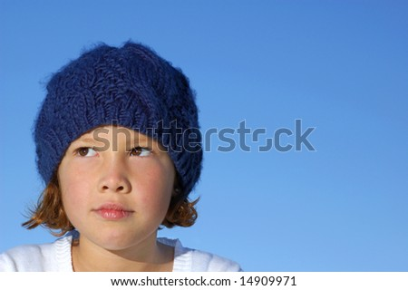 Young girl in blue hat - stock photo