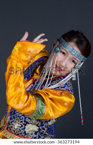 Young girl in Buryat national costume dances