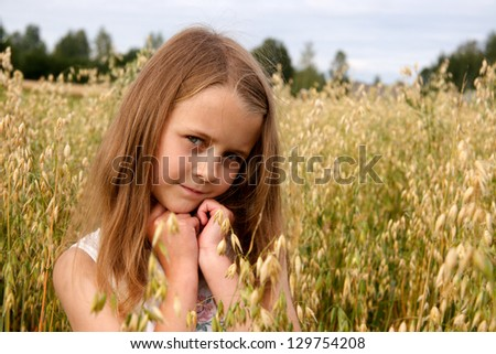 Young girl in country at cornfield - stock photo