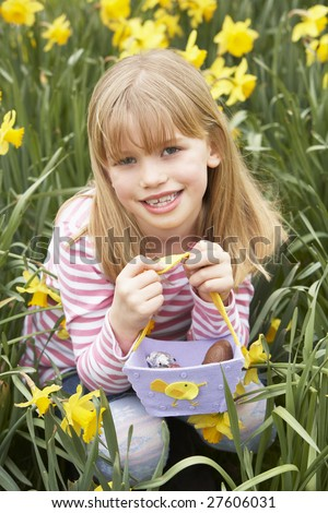 Young Girl In Daffodils At Easter - stock photo