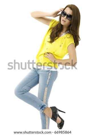 young girl in fashion dress wearing sunglasses posing - stock photo