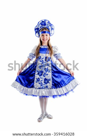 young girl in folk traditional carnival costume, blue and white fluffy skirt