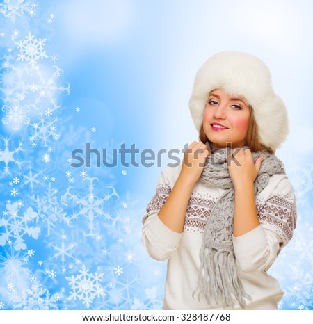 Young girl in fur hat on winter background - stock photo