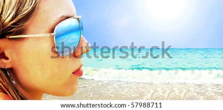 Young girl in Glasses is looking on the tropical sun beach - stock photo