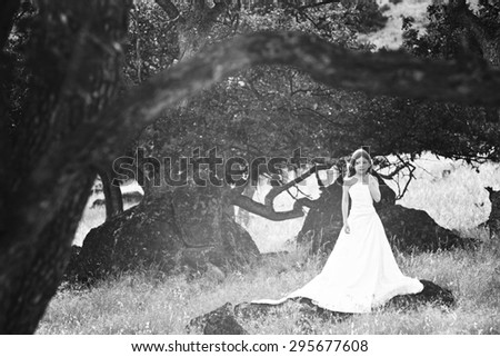 Young girl in her mom's wedding dress - stock photo