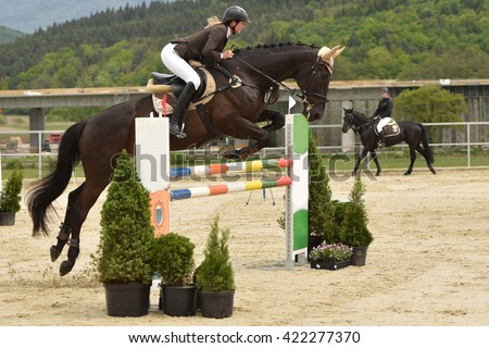Young girl in jumping show