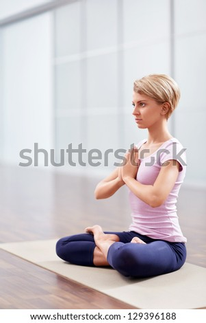Young girl in lotus position