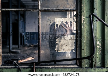 Young girl in old, ruined factory