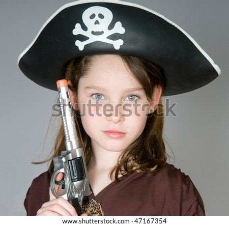 Young girl in pirate costume