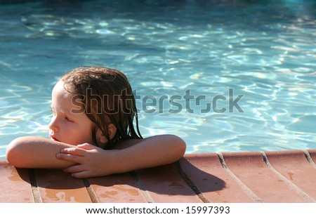 Young girl in pool - stock photo