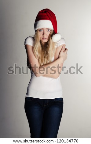 young girl in red santa hat freezing - stock photo