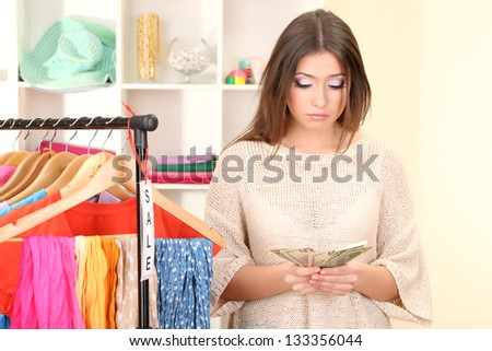Young girl in shop buying clothes