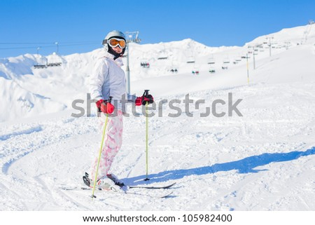 Young girl in ski outfit in the Zillertal Arena, Austria - stock photo