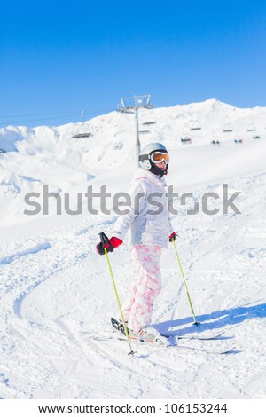 Young girl in ski outfit in the Zillertal Arena, Austria. Vertical view - stock photo