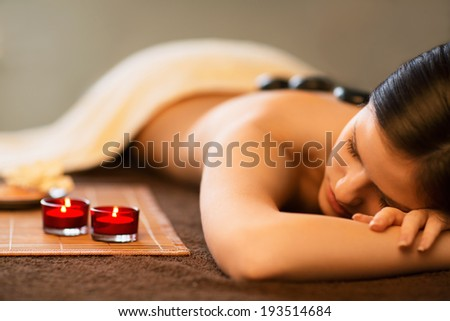 Young girl in spa salon - stock photo