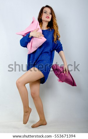 young girl in sweater with cushions