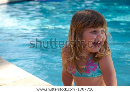 young girl in swimming pool - stock photo