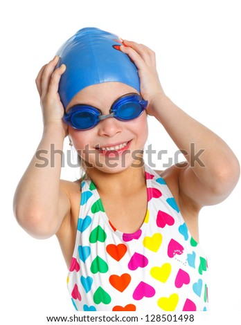 Young girl in swimsuit and swimming goggles over white background - stock photo