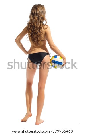 Young girl in swimsuite with ball isolated - stock photo