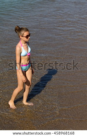 young girl in the evening on the beach, seascape