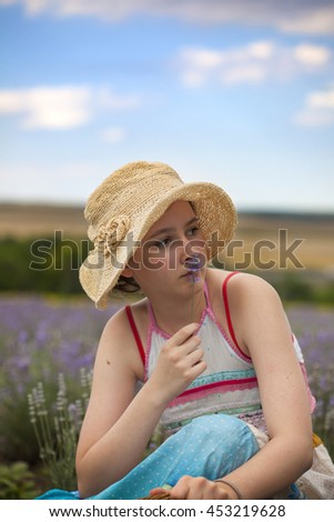 Young girl in the field of lavender in Provence