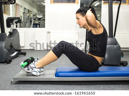 young girl in the gym for sports - stock photo