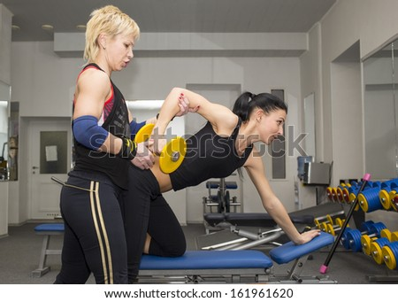 young girl in the gym for sports coach